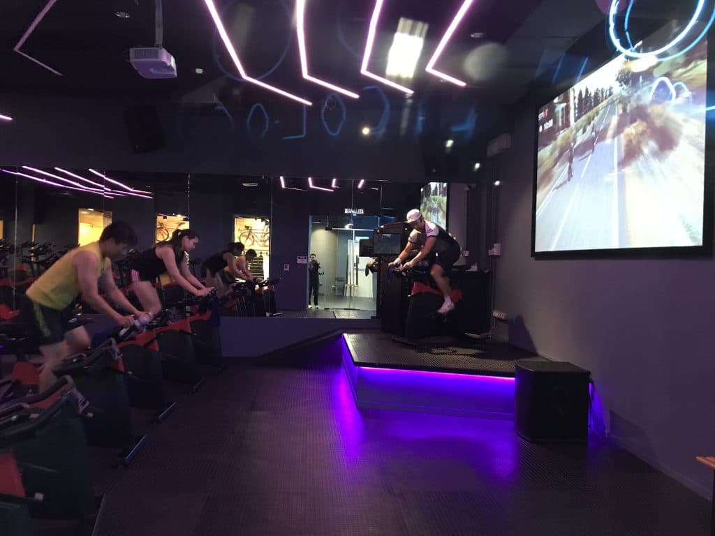 Don Chan running a class at Cycology