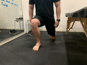 Patient showing a single leg squat 1