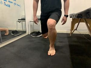 Patient showing a single leg squat 2